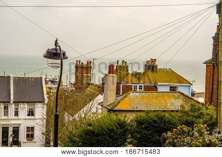 Roofs Of Buildings Covered With Green Moss, Seaside Spot Seen From The Bird's Eye View, Beautiful Ty