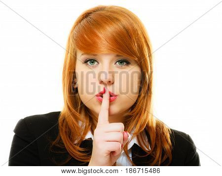 Business woman redhaired girl asking for silence or secrecy with finger on lips hush hand gesture. Isolated