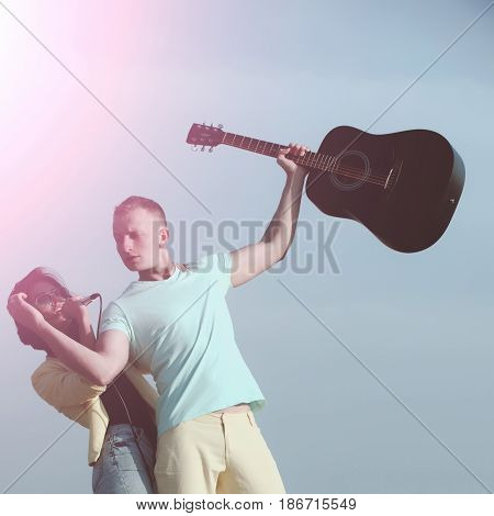 Romantic Couple Of Musicians Performing On Natural Environment