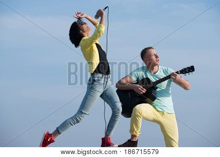 Pretty Girl Singing And Handsome Man Playing Guitar