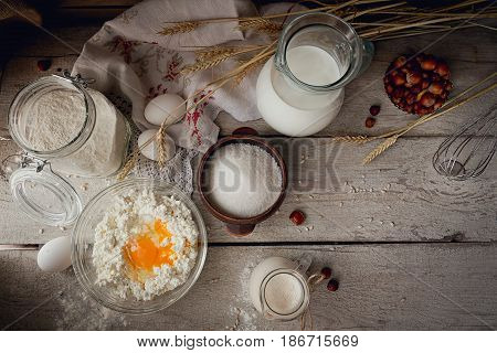 Fresh dairy products. Milk cottage cheese sour cream and wheat on rustic wooden background. Organic farming dairy concept. Top view