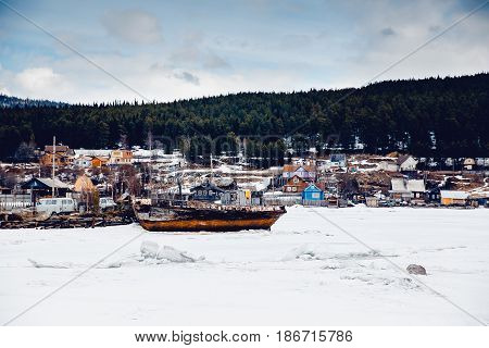 Kandalaksha. Bay of the white sea. Parking for abandoned ships. The concept of storing wooden ghost ships.