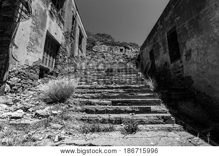 The ruins of the leper colony closed in the 50s on the ruins of a Venetian fortress on Spinalonga island. Crete. Greece. Black and white.