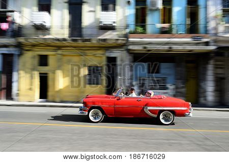 HAVANA CUBA - 07 DECEMBER 2016: Old American cars serving as taxis for tourists in order to go on a tour of old Havana Cuba