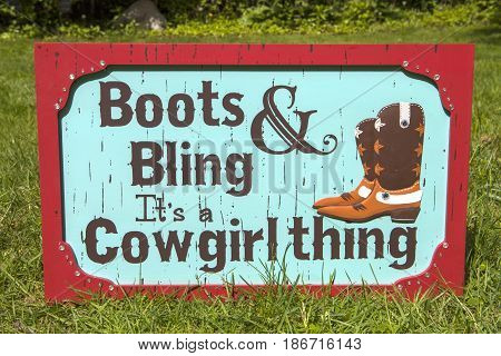 A western themed cowgirl boots and bling sign
