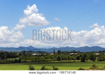 A Fertile Valley In Front Of A Ridge On A Sunny Summer Day