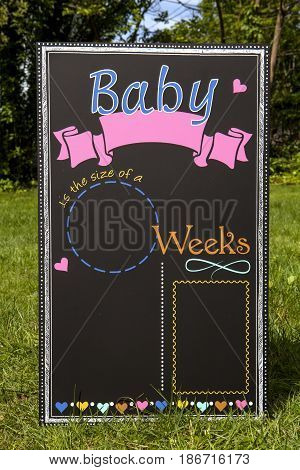 A baby themed chalkboard countdown sign decoration