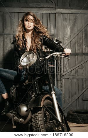 Pretty Girl Biker In Leather Jacket Sitting On Vintage Motorcycle