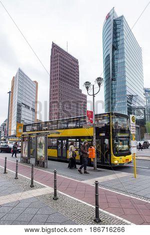 BERLIN GERMANY - APRIL 7: Yellow sightseeing bus at Potsdamer platz on April 7 2017 in Berlin