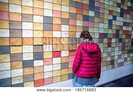 BERLIN GERMANY - APRIL 7: Woman looking on exhibit at museum Topography of Terror on April 7 2017 in Berlin