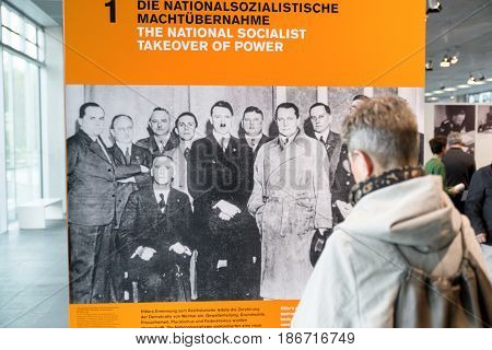 BERLIN GERMANY - APRIL 7: Man looking on photography of Adolf Hitler at museum Topography of Terroron April 7 2017 in Berlin