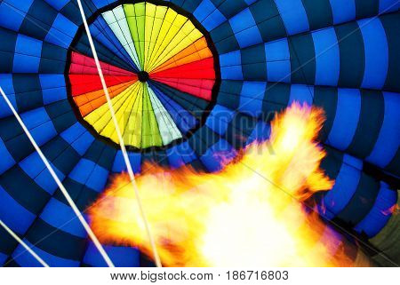hot air ballooning , looking up, and blown to the ground by fire