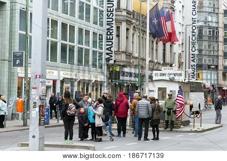 BERLIN GERMANY - APRIL 7: Checkpoint Charlie - Berlin Wall crossing point between East and West Berlin during the Cold War on April 7 2017 in Berlin