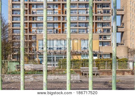 Council Housing Block Seen Through Bar Fence