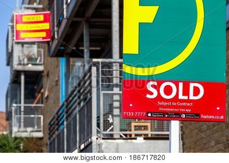 Estate Agency Sold Sign Outside A English Townhouse