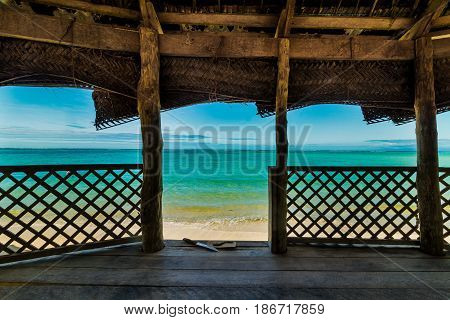 view at the ocean from fale bungalov on white sand beach