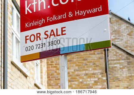 For Sale Signs Outside A English Townhouse