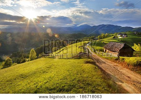 Beautiful spring landscape with old farm in carpathian mountains, Romania