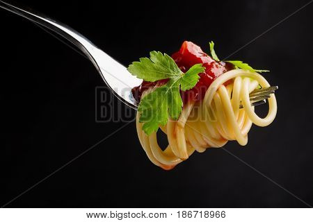 Fork italian food spaghetti carbohydrate isolated closeup tomato sauce