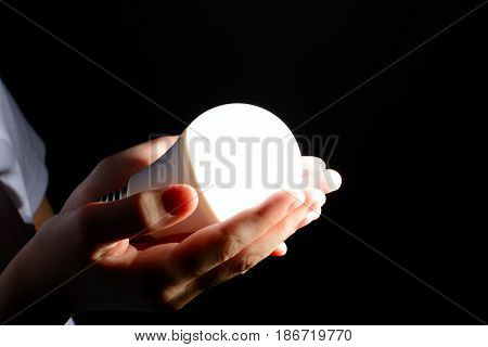 Children's Hands Holding A Glowing Led Light In The Dark