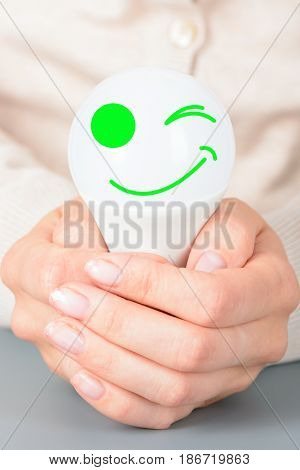 Female Hands Holding A Led Light Bulb