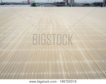 Surface of the roof sheet metal or corrugated roof of factory building or warehouse.