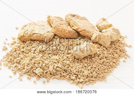 Soy flakes and meat on white background