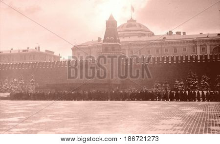 Moscow, Russia - December, 1965: The queue at Lenin's Mausoleum on Red Square on a snowy day.