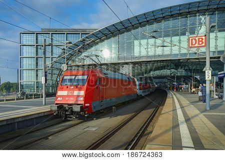 BERLIN, SEP, 27, 2008: View on German Deutsche Bahn red electric locomotive with high speed intercity passenger coaches at main railway station Hauptbahnhof, rail tracks, open platform. Berlin tours