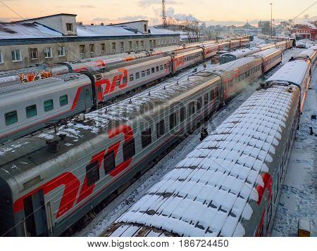 MOSCOW, RUSSIA, DEC,13, 2016: Winter view from above on TVZ russian passenger trains coaches at under maintenance in Moskva Tretiya passenger trains and locomotive depot of Russian Rail Roads RZD cars