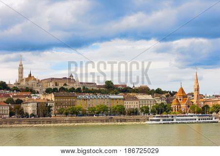 View of the Buda side of Budapest on a sunny day by the Danube river