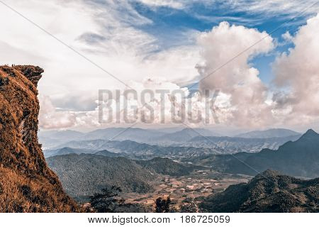 Vintage style in Sienna-Blue color two tone beautiful landscape nature of peak mountain with cloud and sky in winter at Phu Chi Fa Forest Park Chiang Rai Province Thailand