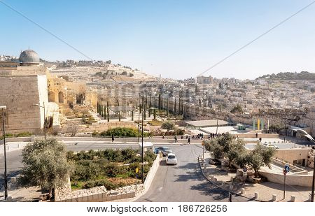 Dome of the Rock Mosque on the Temple Mount and view on the famous Bible symbol - the Mount of Olives in Old Jerusalem city, capital of Israel