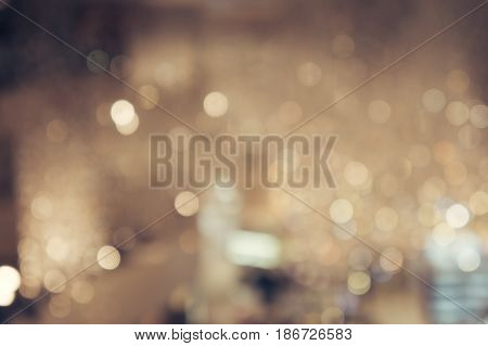 Blur shining brighten soft cream yellow wallpaper with circle lantern : abstract blurred background in light tone, blurry sparkle glitter concept background