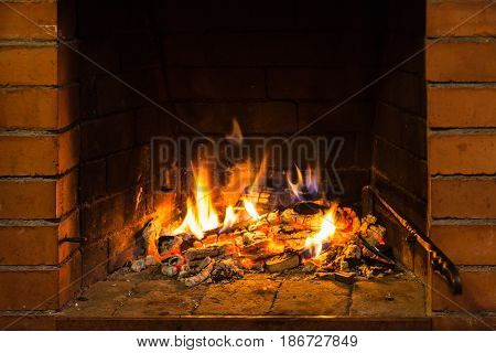 Fire On Burnt Woods In Fireplace