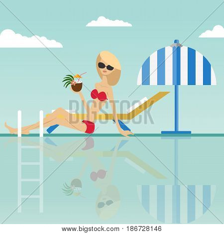 Fashion woman sitting with a coconut cocktail at the edge of swimming pool with deck chair and umbrella