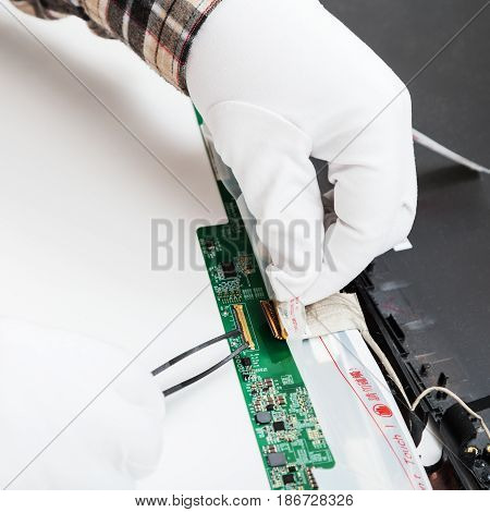 Serviceman In White Gloves Replaces Lcd Screen
