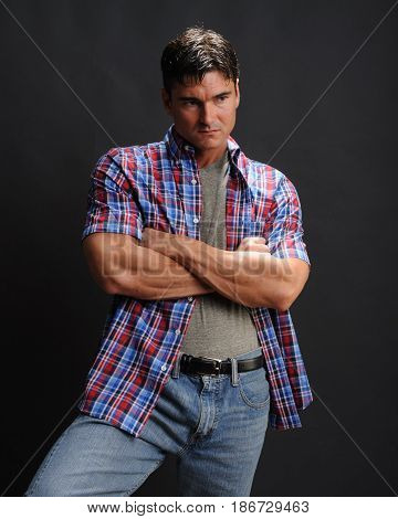 the sexy man is wearing a flannel.