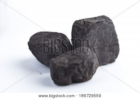 bunch of black coal isolated on white background