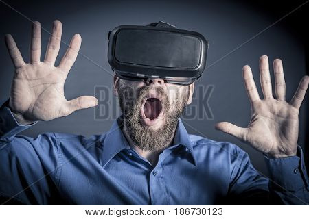 man surprised by virtual reality