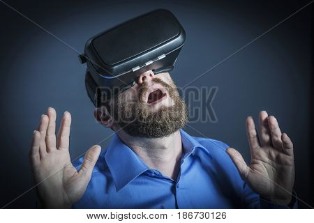 businessman wear virtual reality goggles and enjoy his experience