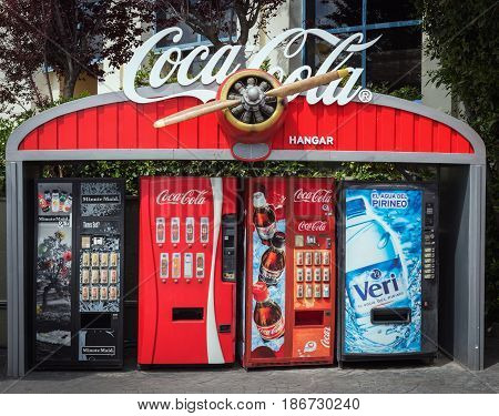 BARCELONA, SPAIN - MAY 2017: Coca Cola soda drink self service machines decorated with vintage aircraft propeller