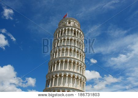 Leaning tower of Pisa Italy on a bright sunny day with blue sky and copy space for text