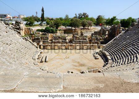 The amphitheater is near rock-cut tombs in Myra Antalya Turkey