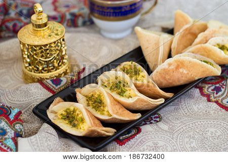 Traditional Arabic Kataif Crepes Stuffed With Cream And Pistachios, Prepared For Iftar In Ramadan, O