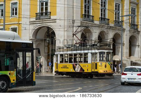 LISBON, PORTUGAL - APRIL 25: Traditional tram by the square Praca do Comercio in Lisbon Portugal on April 25, 2017