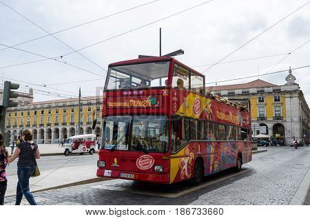 LISBON, PORTUGAL - APRIL 25: Sightseeing bus at Praca do Comercio in Lisbon Portugal on April 25, 2017