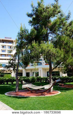 The hammock is on lawn in luxury hotel Antalya Turkey