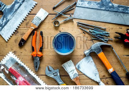 builder work with professional repairing implements set for decorating and painting on wooden background top view poster