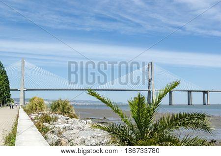 View at the Vasco da Gama bridge from the walkway along the Tajo river April 27, 2017 in Lisbon Portugal